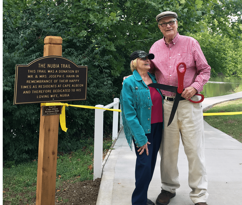 Donors John and Nubia Hahn celebrating the ribbon cutting event
