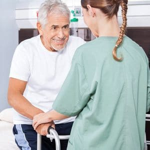 Elderly Hispanic Man Receiving Rehab Services in Assisted Living Home