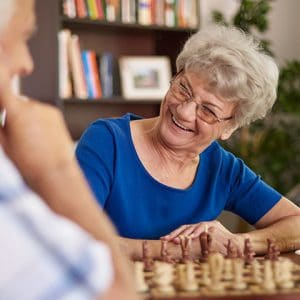 Elderly Woman Playing a Game at Assisted Living Home