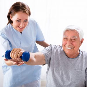 Elder receiving physical therapy at assisted living facility