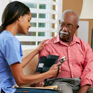 Nurse helping with memory care services