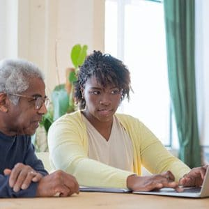 Daughter with Father Deciding on Best Retirement Living Community