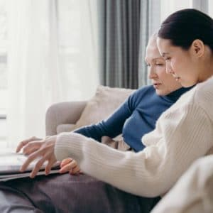 Daughter sitting with mom to discuss retirement living options